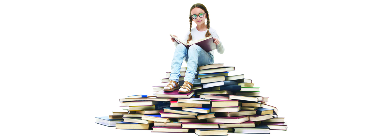 kid on book pile slide